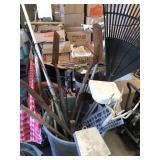 Barrel of yard tools