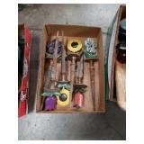 Box of floral metal yard spikes