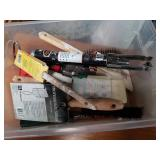 Box of paint brushes and paint brush cleaner