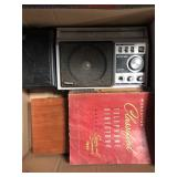 Box with old Panasonic radio, vintage telephone