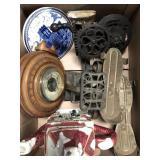 Box of vintage roller skates, wooden clock,