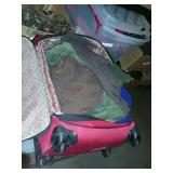Red suitcase full of clothes