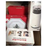 Box of Christmas plates, coffee grinder and mixer