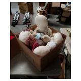 Box of rag dolls and stuffed animals