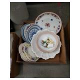 Box of serving bowls and plates
