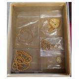 Box of gold costume jewelry