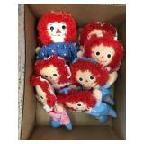 Box of raggedy Ann and Andy dolls