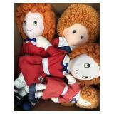 Box of vintage Annie dolls