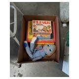 Box of vintage games and Levi ragdoll