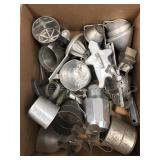 Box of baking items, cookie cutters