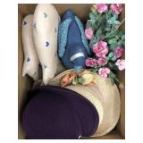 Box of hats and rag doll pigs