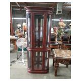 Corner cabinet with beveled glass and round g