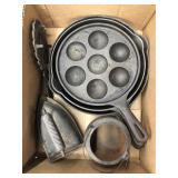 Box of cast iron cookware, iron