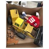 Box of tonal truck, m&m stuffed toy, rolling w