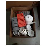 Box of cheese graters and dishes