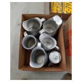 Box of metal pitchers