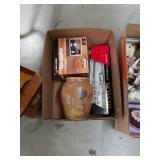 Box of  curling iron and can opener