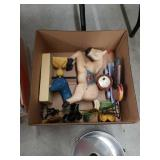 Box of wooden animal decorations and bakeware