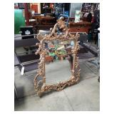 Carved frm.wall mirror