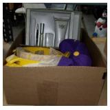 Box of yellow bowls and  D&C products