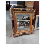 Nicely framed bevel edge mirror