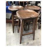 Group of three wooden bar stools