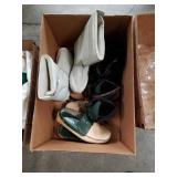Box of Prada shoes and boots