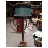 Large wood floor lamp with a hand made lamp shade