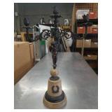 Metal figurine candle holder