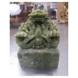 Green stone dragon figure