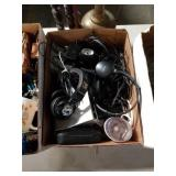 Box of headphones and wires