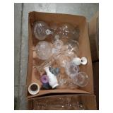 Box of glass vases and candle holders