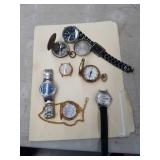 Box with watches, compasses etc