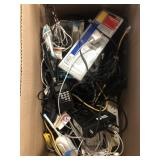 Box of misc electronics, cords, baby monitors,