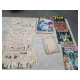 Box of comic books, old newspapers clippings