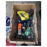 Crate of tools and battery chargers
