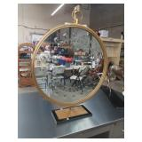 Round retro mirror with marble and metal stand