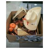 Box of fall decorations ans wreath