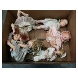 Box of some composite some porcelain dolls