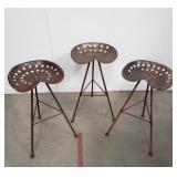 3 modern repurposed metal tractor seat stools