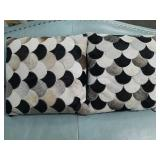 Pair of cow hide decorative pillows