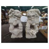 pair of old cement foo dogs. some material damage