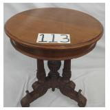 round victorian carved table. missing one