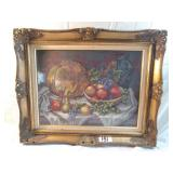 framed needlepoint picture of fruit.
