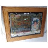 "coca-cola advertising mirror. 24""x 29"". oak frame"
