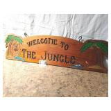"""welcome to the jungle wood carved sign. 11""""x 42"""""""