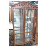 beveled glass oak display cabinet w/lite.