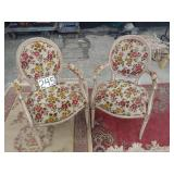 2 floral carved chairs. minor stain on one chair