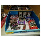 Box of diecast cars and miscellaneous nascar