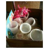 Box of pink flamingos and vases